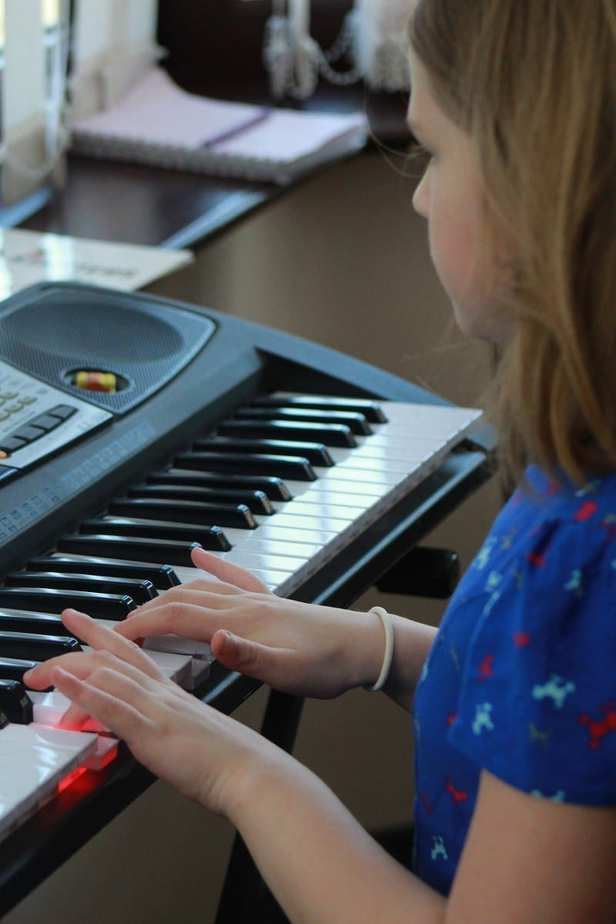 Grace playing the piano
