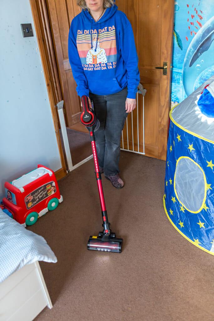 The Moosoo K17U 4 in 1 Handheld Cordless Vacuum being used to clean a child's bedroom.